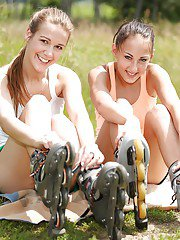 Playful young sweeties have some lesbian fun with their toys outdoor