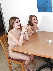 Dirty-minded teenies getting nude and going down on a stiff big boner
