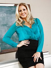 Superb milf with big humps Julia Ann tries on her new sexy stockings