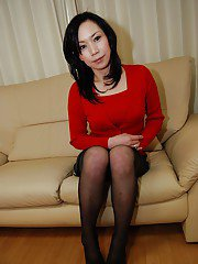Naughty asian MILF in pantyhose undressing and spreading her hairy gash