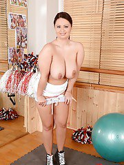 Smiley buxom brunette revealing and exposing her massive natural tatas