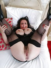 Lecherous mature gal with fatty curves uncovering her jugs and hairy gash