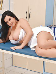 Hot European nurse Roxana manages to lick her own brown nipples