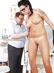 Tattooed brunette in glasses going through full gyno exam with naughty doctor