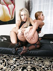 Gorgeous blonde lesbians in fetish outfits have some anal toying fun