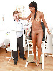 Stunning chick goes through full pussy examination with an older doctor