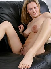 Well-stacked blonde amateur in jeans undressing and teasing her gash