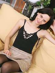 Amateur teen babe Miriam shows what lives under her short skirt