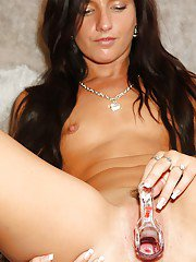 Naughty brunette girlie undressing and playing with gyno tools