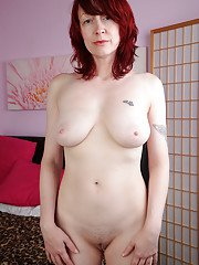 Ideal mature milf Scarlet Rose is a redhead harpy that eats dicks