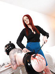 Auburn femdom gives some hot wax and spanking pleasure to her female pet
