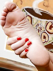 Nifty and amiable mature female Bianca Breeze plays with her feet