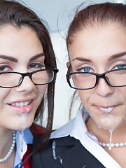 Slutty chicks in dress clothes and glasses blow two black meaty poles