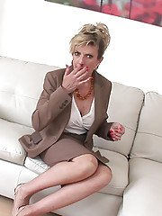 Mature doxy with long legs Sonia talks on the phone and masturbates