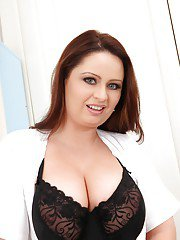 Curvy nurse revealing her amazing huge melons and shaved cooter