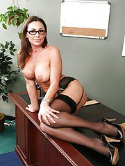 Steamy teacher in glasses stripping down to her nylons and hip-kit
