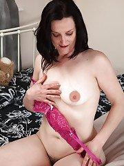 Clothed mature bitch Emily Marshall is opening wide her hairy furbox