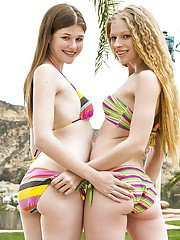 Amateur teen lesbians Avril Hall and Laura Brooks take off bikini.