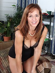 Hot mature woman with big boobs Karen Jones looks great in stockings