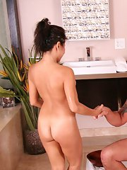 Asian babe Jackie Lin oils and blowjobs tattooed man in the bathroom