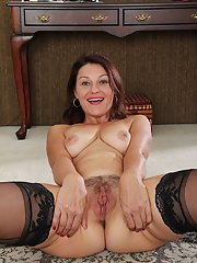 Mature brunette Ava Austin takes off her luxury bra and hot panties