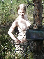Outdoor posing with marvelous teen babe showing her ass in woods