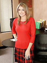 Frolicsome milf Nina Lane demonstrates delicious boobies in office