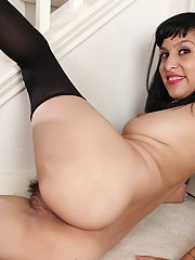 Dangerously hot black haired milf Penelope Patterson with hairy pussy