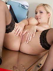 Amateur teen Charlie Baxter in sexy stockings gets naked on the table