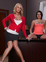 Lesbian milfs Chase Ryder and Simone Sonay frolic in the office