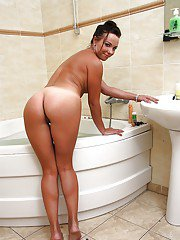 Beautiful milf Alysa Gap with tanlines meets us in the bathroom