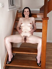 Tiny tits brunette lady Emily Marshall shows her mature hairy puss