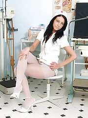Pantyhose model Gabina is posing in her hot white uniform