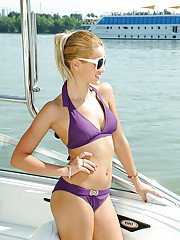 Bikini model Chary is presenting her fantastic body in a violet suit