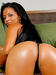 Giggly pornstar Juliana Jambo oils big ass and spreads it