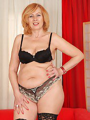 Slutty Lady stripping in black lingerie and playing with mature sissy