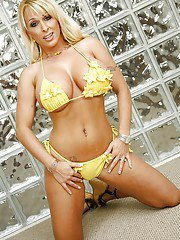 Big tit blonde milf Holly posing in her new yellow lingerie