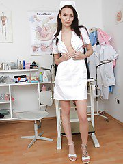 Pretty brunette nurse Belle masturbating pussy with a vibrator