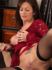 Mature slut Lucy has huge tits and nipples and a cute piercing in cunt