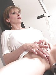 Mature big tit Lady loves sport and masturbating her wet pussy