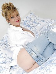 Alluring mature Lady Sonia stripping in bedroom and showing tits