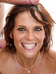 Big tit brunette milf gets fucked deep in all her holes at the same time