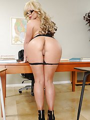 Awesome big tit and ass pornstar milf Phoenix spreading her legs