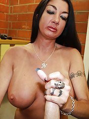 Awesome brunette milf with big tits giving a stunning handjob