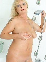 Nasty blonde big tit mature Rita showing her pussy in the shower