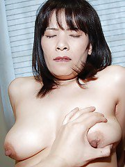 Awesome mature asian with big tits Yumiko masturbatin pussy