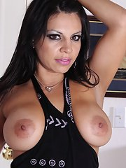 Awesome brunette milf with big nipples undressing her shaved pussy