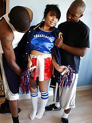 Awesome asian cheerleader May gets banged by these two black cocks