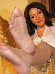 Amazing pantyhose loving brunette Imma is a foot fetish babe