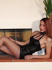Redhead babe Thena loves to demonstrate her awesome pantyhose